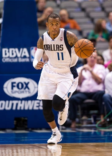 Oct 7, 2013; Dallas, TX, USA; Dallas Mavericks point guard Monta Ellis (11) brings the ball up the court during the game against the New Orleans Pelicans at the American Airlines Center. The Pelicans defeated the Mavericks 94-92. Mandatory Credit: Jerome Miron-USA TODAY Sports