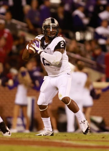 Oct 5, 2013; Norman, OK, USA; TCU Horned Frogs quarterback Trevone Boykin (2) throws a pass against the Oklahoma Sooners at Gaylord Family - Oklahoma Memorial Stadium. The Oklahoma Sooners beat the TCU Horned Frogs 20-17. Mandatory Credit: Tim Heitman-USA TODAY Sports