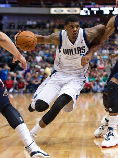 Oct 7, 2013; Dallas, TX, USA; Dallas Mavericks shooting guard Ricky Ledo (7) drives to the basket during the game against the New Orleans Pelicans at the American Airlines Center. The Pelicans defeated the Mavericks 94-92. Mandatory Credit: Jerome Miron-USA TODAY Sports