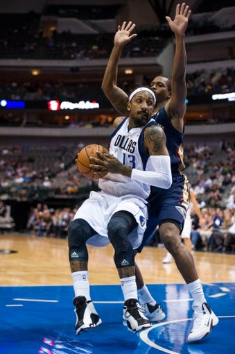 Oct 7, 2013; Dallas, TX, USA; Dallas Mavericks small forward Renaldo Balkman (13) drives to the basket as New Orleans Pelicans small forward Lance Thomas (42) defends during the game at the American Airlines Center. The Pelicans defeated the Mavericks 94-92. Mandatory Credit: Jerome Miron-USA TODAY Sports