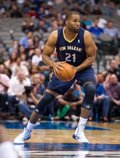 Oct 7, 2013; Dallas, TX, USA; New Orleans Pelicans power forward Arinze Onuaku (21) brings the ball up the court during the game Dallas Mavericks at the American Airlines Center. The Pelicans defeated the Mavericks 94-92. Mandatory Credit: Jerome Miron-USA TODAY Sports