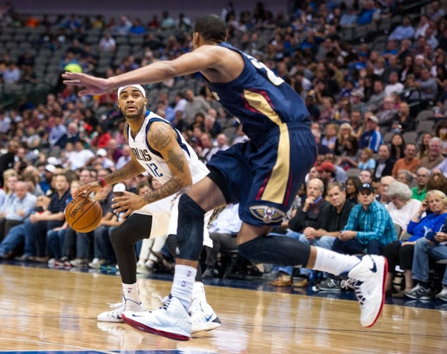 Oct 7, 2013; Dallas, TX, USA; New Orleans Pelicans power forward Anthony Davis (23) guards Dallas Mavericks shooting guard D.J. Kennedy (12) during the game at the American Airlines Center. The Pelicans defeated the Mavericks 94-92. Mandatory Credit: Jerome Miron-USA TODAY Sports