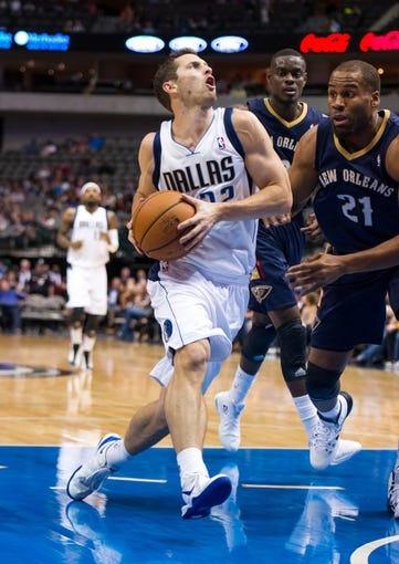 Oct 7, 2013; Dallas, TX, USA; Dallas Mavericks forward Richard McConnell (32) drives to the basket past New Orleans Pelicans power forward Arinze Onuaku (21) during the game at the American Airlines Center. The Pelicans defeated the Mavericks 94-92. Mandatory Credit: Jerome Miron-USA TODAY Sports