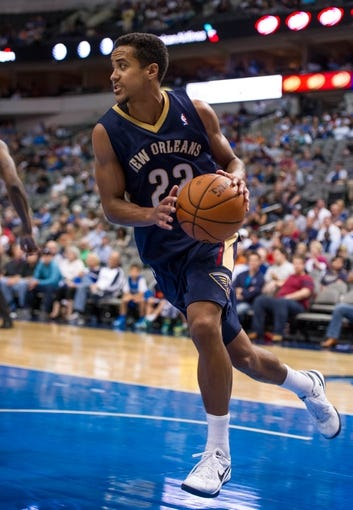 Oct 7, 2013; Dallas, TX, USA; New Orleans Pelicans point guard Brian Roberts (22) dribbles the ball during the game against the Dallas Mavericks at the American Airlines Center. The Pelicans defeated the Mavericks 94-92. Mandatory Credit: Jerome Miron-USA TODAY Sports