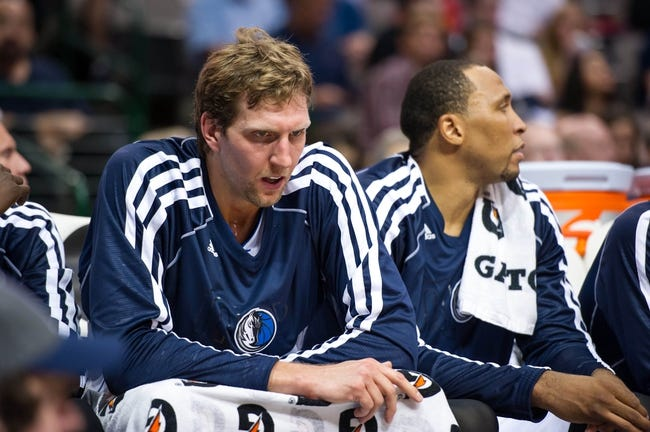 Oct 7, 2013; Dallas, TX, USA; Dallas Mavericks power forward Dirk Nowitzki (41) and small forward Shawn Marion (0) sit on the bench against the New Orleans Pelicans at the American Airlines Center. The Pelicans defeated the Mavericks 94-92. Mandatory Credit: Jerome Miron-USA TODAY Sports