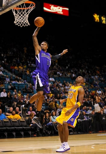 Oct 10, 2013; Las Vegas, NV, USA; Sacramento Kings guard Ben McLemore (16) goes up to dunk the ball above Los Angeles Lakers guard Jodie Meeks (20) during an NBA preseason game at MGM Grand Arena. The Kings won the game 104-86. Mandatory Credit: Stephen R. Sylvanie-USA TODAY Sports