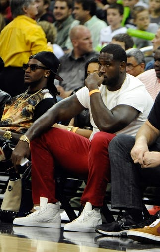 Oct 11, 2013; Kansas City, MO, USA; Kansas City Chiefs tackle Brandon Albert watches the game between the Charlotte Bobcats and Miami Heat in the first half at Sprint Center. Miami won 86-75. Mandatory Credit: John Rieger-USA TODAY Sports