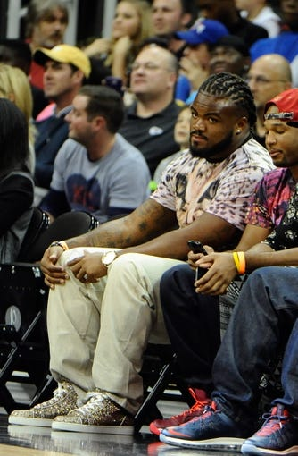 Oct 11, 2013; Kansas City, MO, USA; Kansas City Chiefs defensive tackle Dontari Poe watches the game between the Charlotte Bobcats and Miami Heat in the first half at Sprint Center. Miami won 86-75. Mandatory Credit: John Rieger-USA TODAY Sports