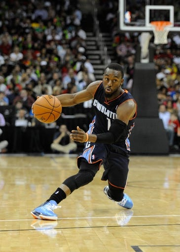 Oct 11, 2013; Kansas City, MO, USA; Charlotte Bobcats point guard Kemba Walker (15) dribbles against the Miami Heat in the first half at Sprint Center. Miami won 86-75. Mandatory Credit: John Rieger-USA TODAY Sports