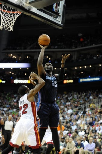 Oct 11, 2013; Kansas City, MO, USA; Charlotte Bobcats center Al Jefferson (25) shoots against Miami Heat small forward James Jones (22) in the first half at Sprint Center. Miami won 86-75. Mandatory Credit: John Rieger-USA TODAY Sports