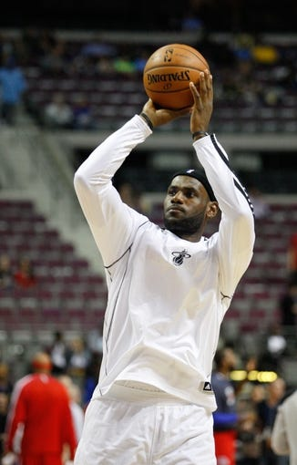 Oct 10, 2013; Auburn Hills, MI, USA; Miami Heat small forward LeBron James (6) warms up before the game against the Detroit Pistons at The Palace of Auburn Hills. Mandatory Credit: Raj Mehta-USA TODAY Sports