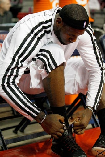 Oct 10, 2013; Auburn Hills, MI, USA; Miami Heat small forward LeBron James (6) ties his shoe before the game against the Detroit Pistons at The Palace of Auburn Hills. Mandatory Credit: Raj Mehta-USA TODAY Sports
