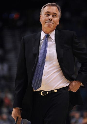 Oct 10, 2013; Las Vegas, NV, USA; Los Angeles Lakers head coach Mike D'Antoni looks toward the crowd after calling a time out during an NBA preseason game against the Sacramento Kings at MGM Grand Arena. The Kings won the game 104-86. Mandatory Credit: Stephen R. Sylvanie-USA TODAY Sports
