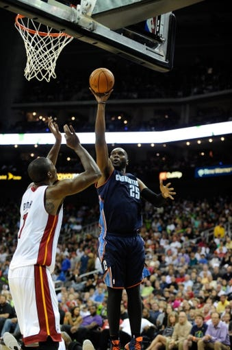 Oct 11, 2013; Kansas City, MO, USA; Charlotte Bobcats center Al Jefferson (25) shoots against Miami Heat power forward Chris Bosh (1) in the first half at Sprint Center. Miami won 86-75. Mandatory Credit: John Rieger-USA TODAY Sports