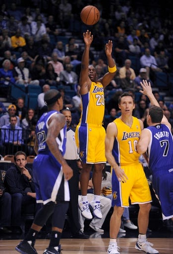 Oct 10, 2013; Las Vegas, NV, USA; Los Angeles Lakers guard Jodie Meeks (20) takes a jump shot as Lakers guard Steve Nash (10) sets a pick on Sacramento Kings guard Jimmer Fredette (7) during an NBA preseason game at MGM Grand Arena. The Kings won the game 104-86. Mandatory Credit: Stephen R. Sylvanie-USA TODAY Sports