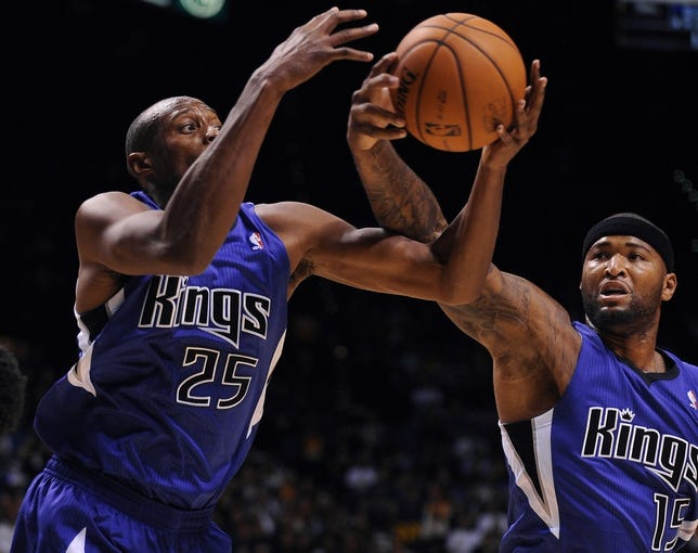 Oct 10, 2013; Las Vegas, NV, USA; Sacramento Kings forward Travis Outlaw (25) and center DeMarcus Cousins (15) vie for a defensive rebound during an NBA preseason game against the Los Angeles Lakers at MGM Grand Arena. The Kings won the game 104-86. Mandatory Credit: Stephen R. Sylvanie-USA TODAY Sports