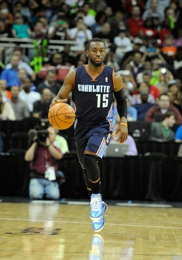 Oct 11, 2013; Kansas City, MO, USA; Charlotte Bobcats point guard Kemba Walker (15) brings the ball up court against the Miami Heat in the first half at Sprint Center. Miami won 86-75. Mandatory Credit: John Rieger-USA TODAY Sports