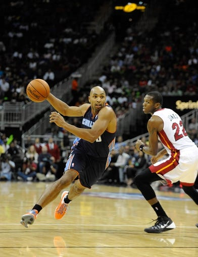 Oct 11, 2013; Kansas City, MO, USA; Charlotte Bobcats shooting guard Gerald Henderson (9) drives to the basket against Miami Heat small forward James Jones (22) in the first half at Sprint Center. Miami won 86-75. Mandatory Credit: John Rieger-USA TODAY Sports