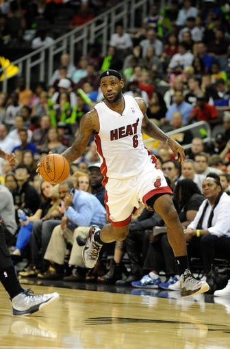 Oct 11, 2013; Kansas City, MO, USA; Miami Heat small forward LeBron James (6) dribbles the ball against the Charlotte Bobcats in the second half at Sprint Center. Miami won 86-75. Mandatory Credit: John Rieger-USA TODAY Sports