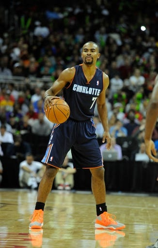 Oct 11, 2013; Kansas City, MO, USA; Charlotte Bobcats point guard Ramon Sessions (7) looks to pass against the Miami Heat in the first half at Sprint Center. Miami won 86-75. Mandatory Credit: John Rieger-USA TODAY Sports