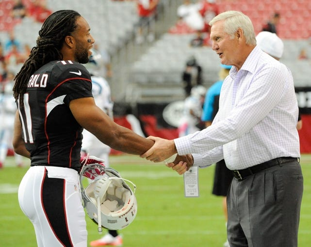 Oct 6, 2013; Phoenix, AZ, USA; Retired basketball player Jerry West and Arizona Cardinals wide receiver Larry Fitzgerald (11) shake hands during warm ups before the first quarter against the Carolina Panthers at University of Phoenix Stadium. The Cardinals beat the Panthers 22-6. Mandatory Credit: Casey Sapio-USA TODAY Sports