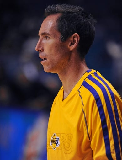 Oct 10, 2013; Las Vegas, NV, USA; Los Angeles Lakers guard Steve Nash participates in warmups before an NBA preseason game against the Sacramento Kings at MGM Grand Arena. The Kings won the game 104-86. Mandatory Credit: Stephen R. Sylvanie-USA TODAY Sports