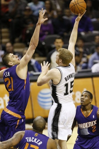 Oct 13, 2013; San Antonio, TX, USA; San Antonio Spurs forward Matt Bonner (15) takes a shot over Phoenix Suns  center Alex Len (21) during the first half at AT&T Center. Mandatory Credit: Soobum Im-USA TODAY Sports