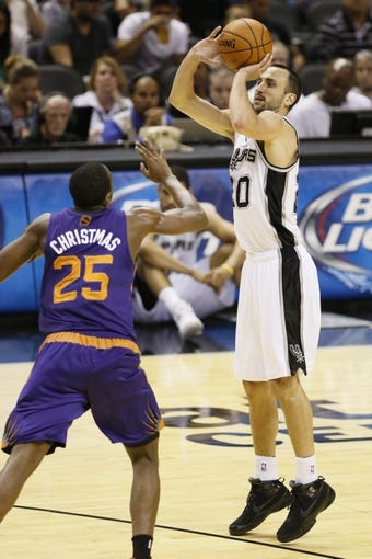 Oct 13, 2013; San Antonio, TX, USA; San Antonio Spurs guard Manu Ginobili (20) shoots against Phoenix Suns  guard Dionte Christmas (25) during the first half at AT&T Center. Mandatory Credit: Soobum Im-USA TODAY Sports