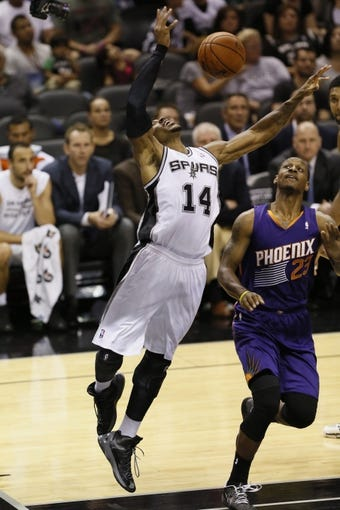 Oct 13, 2013; San Antonio, TX, USA; San Antonio Spurs forward Corey Maggette (14) gets fouled while shooting against Phoenix Suns  forward James Nunnally (23) during the first half at AT&T Center. Mandatory Credit: Soobum Im-USA TODAY Sports