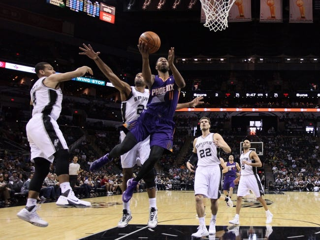 Oct 13, 2013; San Antonio, TX, USA; Phoenix Suns  forward Markieff Morris (11) drives for the basket past San Antonio Spurs forward Tim Duncan (21) during the first half at AT&T Center. Mandatory Credit: Soobum Im-USA TODAY Sports