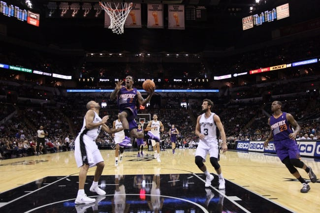 Oct 13, 2013; San Antonio, TX, USA; Phoenix Suns  guard Eric Bledsoe (2) drives to the basket while guarded by San Antonio Spurs guard Tony Parker (9) during the first half at AT&T Center. Mandatory Credit: Soobum Im-USA TODAY Sports