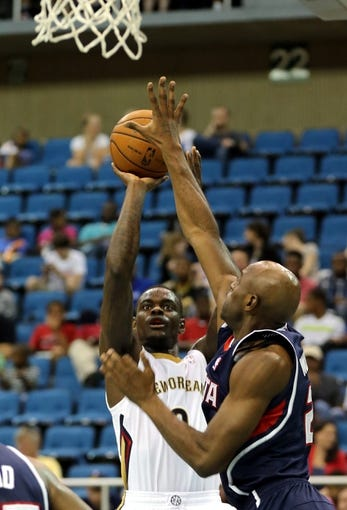 Oct 13, 2013; Biloxi, MS, USA; New Orleans Pelicans shooting guard Anthony Morrow (3) shoots over Atlanta Hawks shooting guard Damien Wilkins (2)during the second half of their game at the Mississippi Coast Coliseum. The Pelicans won 105-73. Mandatory Credit: Chuck Cook-USA TODAY Sports