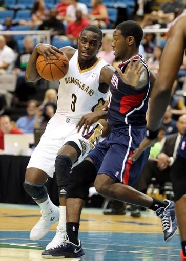 Oct 13, 2013; Biloxi, MS, USA; New Orleans Pelicans shooting guard Anthony Morrow (3) drives around Atlanta Hawks point guard Royal Ivey (10) during the second half of their game at the Mississippi Coast Coliseum. The Pelicans won 105-73. Mandatory Credit: Chuck Cook-USA TODAY Sports