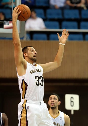 Oct 13, 2013; Biloxi, MS, USA; New Orleans Pelicans power forward Ryan Anderson (33) grabs a rebound against the Atlanta Hawks during the second half of their game at the Mississippi Coast Coliseum. The Pelicans won 105-73. Mandatory Credit: Chuck Cook-USA TODAY Sports