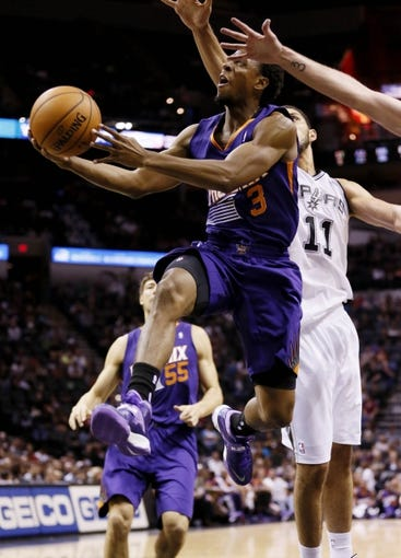 Oct 13, 2013; San Antonio, TX, USA; Phoenix Suns  guard Ish Smith (3) drives to the basket past San Antonio Spurs forward Jeff Ayres (11) during the second half at AT&T Center. The Suns won 106-99. Mandatory Credit: Soobum Im-USA TODAY Sports