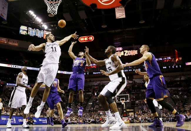 Oct 13, 2013; San Antonio, TX, USA; Phoenix Suns  guard Ish Smith (3) takes a shot over San Antonio Spurs forward Jeff Ayres (11) during the second half at AT&T Center. The Suns won 106-99. Mandatory Credit: Soobum Im-USA TODAY Sports