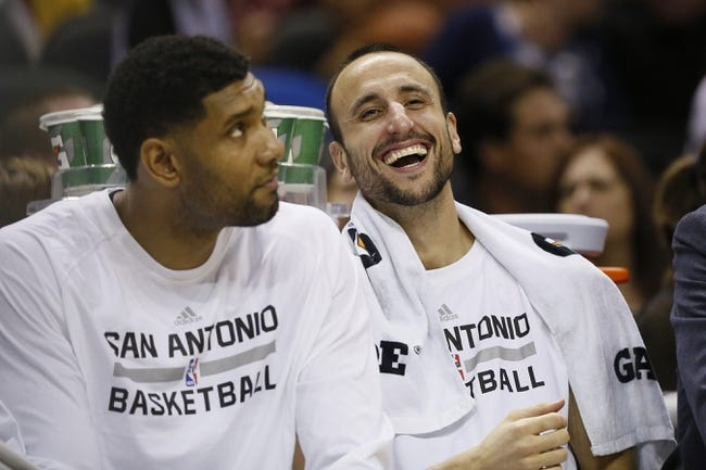 Oct 13, 2013; San Antonio, TX, USA; San Antonio Spurs guard Manu Ginobili (right) laughs with forward Tim Duncan (left) during the second half against the Phoenix Suns at AT&T Center. The Suns won 106-99. Mandatory Credit: Soobum Im-USA TODAY Sports