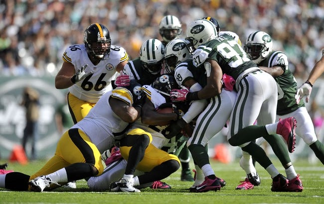 Oct 13, 2013; East Rutherford, NJ, USA; Pittsburgh Steelers running back Felix Jones (23) is gang tackled by New York Jets defenders during the second half at MetLife Stadium. The Steelers won the game 19-6. Mandatory Credit: Joe Camporeale-USA TODAY Sports
