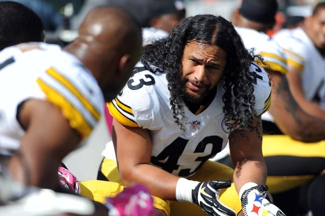 Oct 13, 2013; East Rutherford, NJ, USA; Pittsburgh Steelers strong safety Troy Polamalu (43) talks with teammates on the bench during the first half against the New York Jets at MetLife Stadium. The Steelers won the game 19-6. Mandatory Credit: Joe Camporeale-USA TODAY Sports
