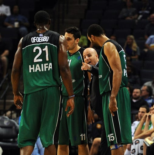 Oct 13, 2013; Memphis, TN, USA; Haifa head coach Danny Franco talks to team during a timeout in the second quarter at FedExForum. Mandatory Credit: Justin Ford-USA TODAY Sports