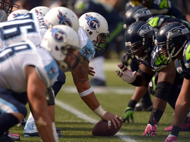 Oct 13, 2013; Seattle, WA, USA; General view of the line of scrimmage as Tennessee Titans center Rob Turner (59) snaps the ball against the Seattle Seahawks at CenturyLink Field. The Seahawks defeated the Titans 20-13. Mandatory Credit: Kirby Lee-USA TODAY Sports