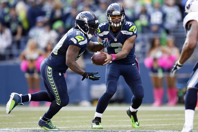 Oct 13, 2013; Seattle, WA, USA; Seattle Seahawks quarterback Russell Wilson (3) fakes a hand off to Seattle Seahawks running back Marshawn Lynch (24) against the Tennessee Titans during the second half at CenturyLink Field. Mandatory Credit: Joe Nicholson-USA TODAY Sports