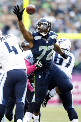 Oct 13, 2013; Seattle, WA, USA; Seattle Seahawks defensive end Michael Bennett (72) rushes the passer  against the Tennessee Titans during the second half at CenturyLink Field. Mandatory Credit: Joe Nicholson-USA TODAY Sports