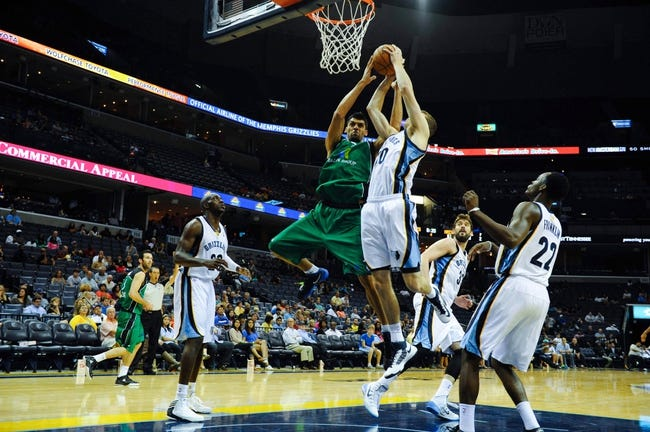 Oct 13, 2013; Memphis, TN, USA; Haifa center Alex Chubrevich (7) and Memphis Grizzlies power forward Jon Leuer (30) fight for a rebound during the second half at FedExForum. Memphis Grizzlies defeat Haifa 116-70. Mandatory Credit: Justin Ford-USA TODAY Sports