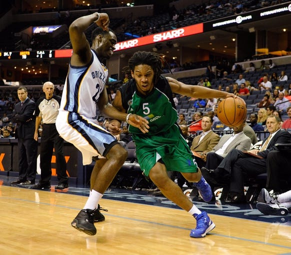 Oct 13, 2013; Memphis, TN, USA; Haifa guard Sherwood Brown (5) drives the ball against Memphis Grizzlies shooting guard Jamaal Franklin (22) during the second half at FedExForum. Memphis Grizzlies defeat Haifa 116-70. Mandatory Credit: Justin Ford-USA TODAY Sports