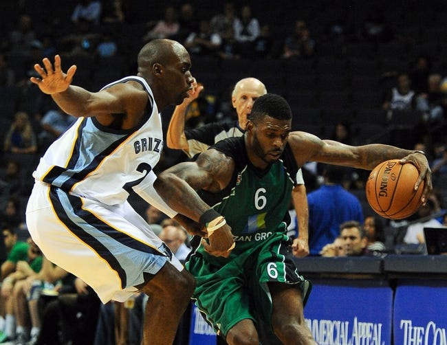 Oct 13, 2013; Memphis, TN, USA; Haifa forward Donta Smith  (6) handles the ball against Memphis Grizzlies small forward Quincy Pondexter (20) during the second half at FedExForum. Memphis Grizzlies defeat Haifa 116-70. Mandatory Credit: Justin Ford-USA TODAY Sports