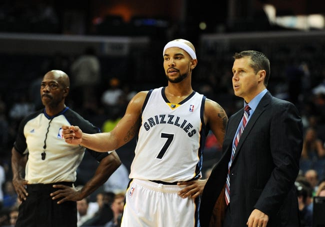 Oct 13, 2013; Memphis, TN, USA; Memphis Grizzlies point guard Jerryd Bayless (7) and Memphis Grizzlies head coach Dave Joerger talk during a timeout against Haifa in the second half at FedExForum. Memphis Grizzlies defeat Haifa 116-70. Mandatory Credit: Justin Ford-USA TODAY Sports