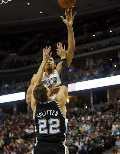 Oct 14, 2013; Denver, CO, USA;  Denver Nuggets center JaVale McGee (34) shoots the ball over San Antonio Spurs forward Tiago Splitter (22) during the first half at Pepsi Center. Mandatory Credit: Chris Humphreys-USA TODAY Sports