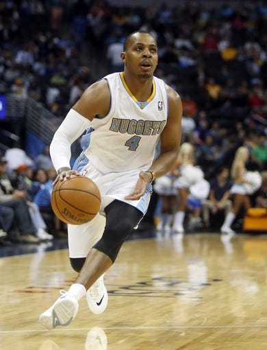 Oct 14, 2013; Denver, CO, USA;  Denver Nuggets guard Randy Foye (4) drives during the first half against the San Antonio Spurs at Pepsi Center. Mandatory Credit: Chris Humphreys-USA TODAY Sports