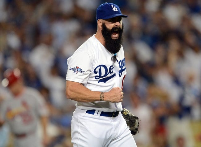 October 14, 2013; Los Angeles, CA, USA; Los Angeles Dodgers relief pitcher Brian Wilson (00) reacts after he pitches the eighth inning against the St. Louis Cardinals in game three of the National League Championship Series baseball game at Dodger Stadium. Mandatory Credit: Jayne Kamin-Oncea-USA TODAY Sports